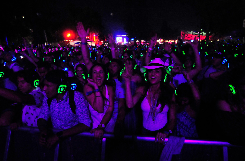 . NAPA, CA - MAY 27, Bottlerockers dance during the silent disco at the Lagunitas Stage. Fans of Warren G are listening to blue head phones and White Panda were playing on the green.(CHRIS RILEY/TIMES-HERALD)