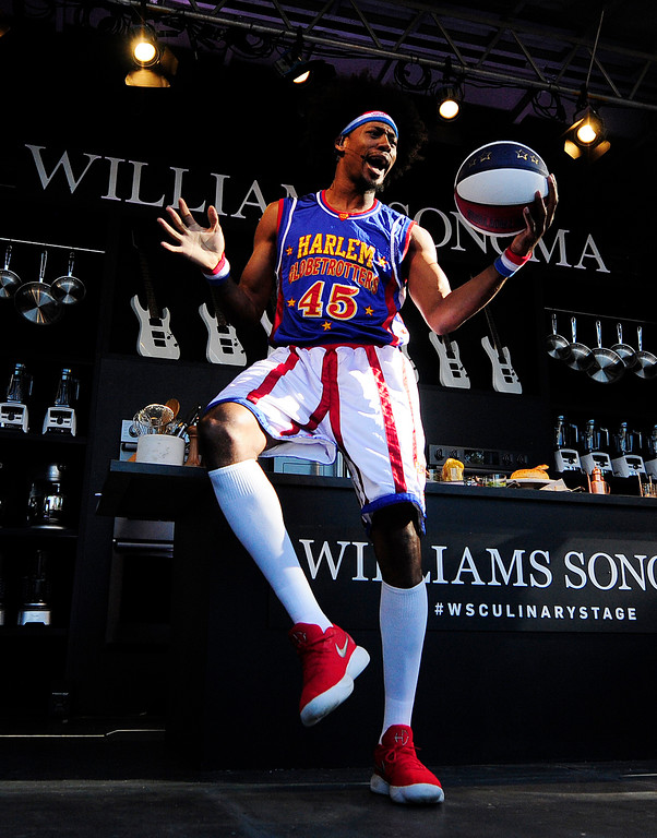 . NAPA, CA- MAY 27, Moose Weekes with the Harlem Globetrotters performs tricks before cooking with Trisha Yearwood on the Williams Sonoma Culinary Stage at the BottleRock Napa Valley Music Festival on Sunday.