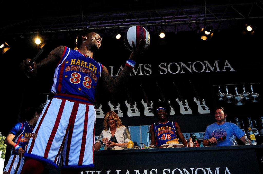 . NAPA, CA- MAY 27, Bull Bullard with the Harlem Globetrotters performs tricks before cooking with Trisha Yearwood on the Williams Sonoma Culinary Stage at the BottleRock Napa Valley Music Festival on Sunday.