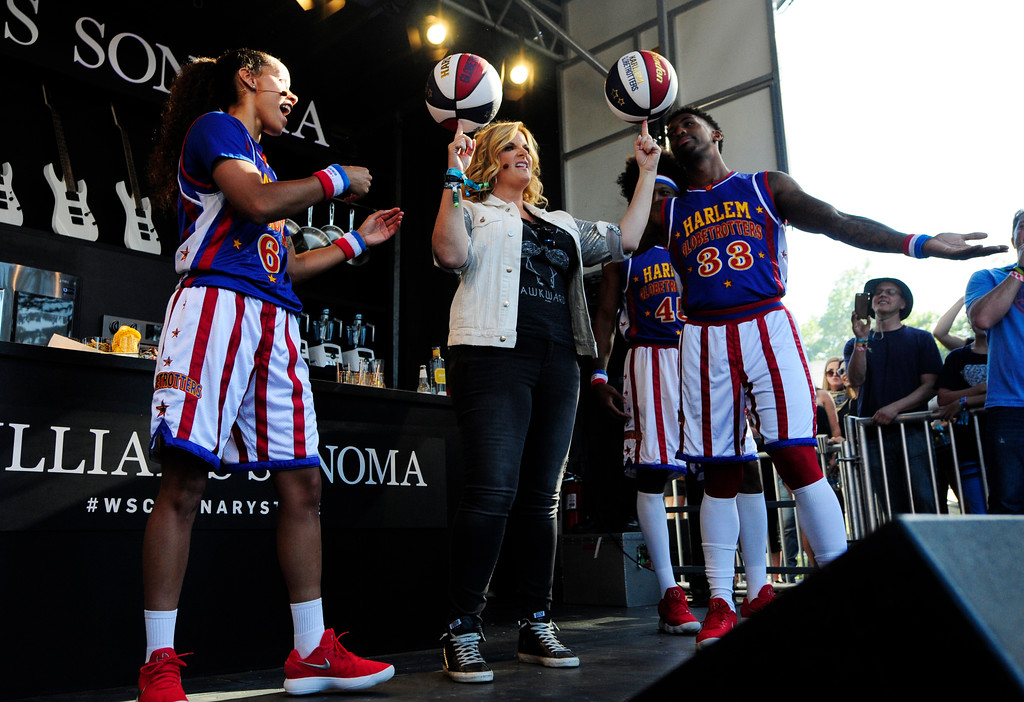 . NAPA, CA- MAY 27, Trisha Yearwood spins two basketballs before cooking with the Harlem Globetrotters on the Williams Sonoma Culinary Stage at the BottleRock Napa Valley Music Festival on Sunday.