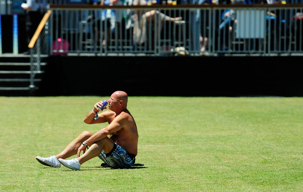 . NAPA, CA - MAY 27, A Bottlerocker enjoys an early beer as he soakes in the sun while holding down his spot in the VIP area while waiting for bands to go on at the Jam Cellars Stage on Sunday, the last day of the BottleRock Napa Valley Music Festival. (CHRIS RILEY/TIMES-HERALD)
