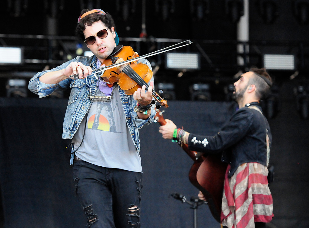 . NAPA, CA-MAY 27, Zambricki Li plays the violin as he performs with Magic Giant on the JaM Cellars Stage on the last day of the BottleRock Napa Valley Music Festival on Sunday.