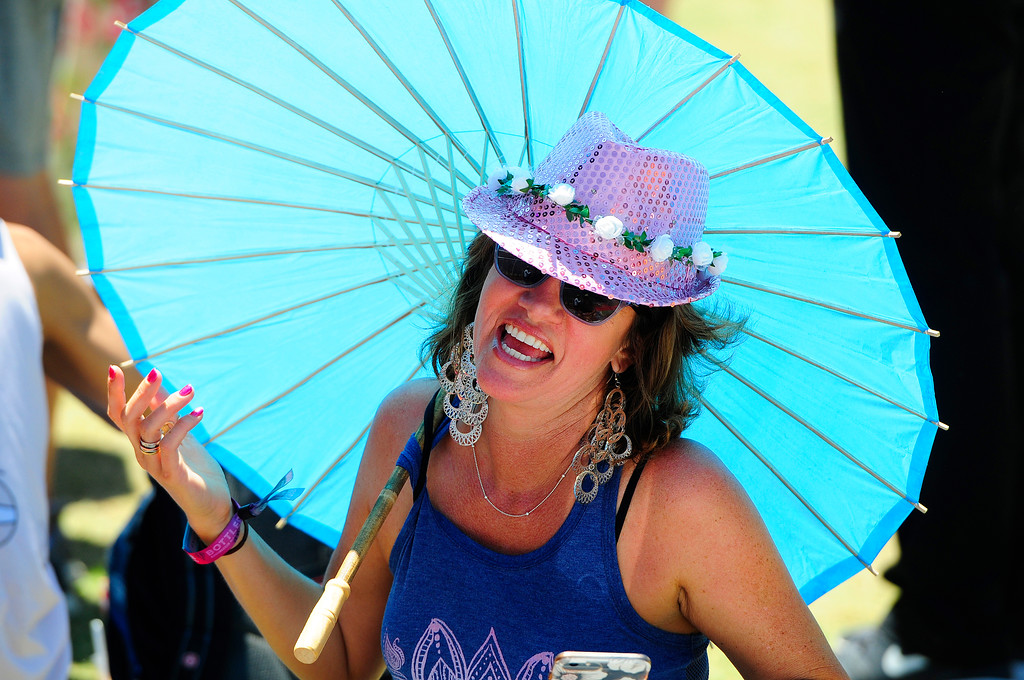 . NAPA, CA-MAY 27, Sky Cooper, from San Ramon, catches some shade as she waits for bands to perform on the JaM Cellars Stage on Sunday, the last day of the BottleRock Napa Valley Music Festival.