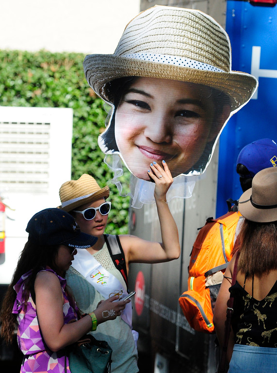 . NAPA, CA - MAY 27, A bride to be carries a large picture of herself on the last day of the BottleRock Napa Valley Music Festival. (CHRIS RILEY/TIMES-HERALD)