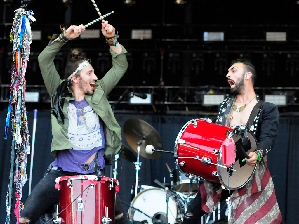 . NAPA, CA-MAY 27, Austin Bisnow, left, plays drums with Zang as they perform with Magic Giant on the JaM Cellars Stage on the last day of the BottleRock Napa Valley Music Festival on Sunday.
