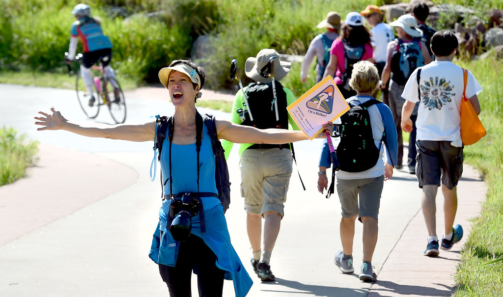 . Darcy Kitching, left, of Walk2Connect, encourages the walkers through Boulder. The Boulder Walk 360 \'Slow marathon,\' is a 26-mile walk around Boulder on Saturday.  For more photos and a video, go to dailycamera.com Cliff Grassmick  Staff Photographer  June 30, 2018
