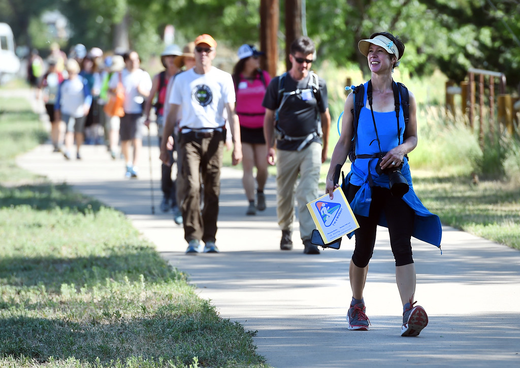 . Darcy Kitching, right, of Walk2Connect, leads the group through Boulder.  The Boulder Walk 360 \'Slow marathon,\' is a 26-mile walk around Boulder on Saturday.  For more photos and a video, go to dailycamera.com Cliff Grassmick  Staff Photographer  June 30, 2018