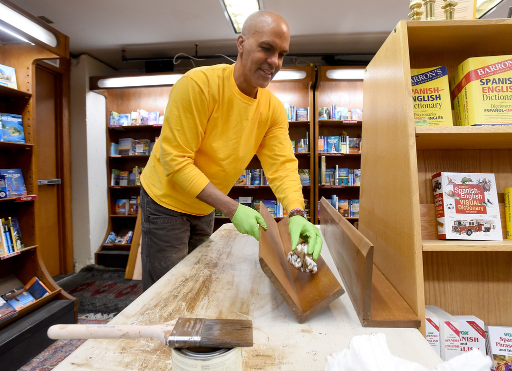 . Thomas Crown refinishes shelves on Thursday. The Boulder Book Store  was named the best book store in the country by Publisher\'s Weekly. For more photos, go to dailycamera.com. Cliff Grassmick  Photographer  March 29, 2018