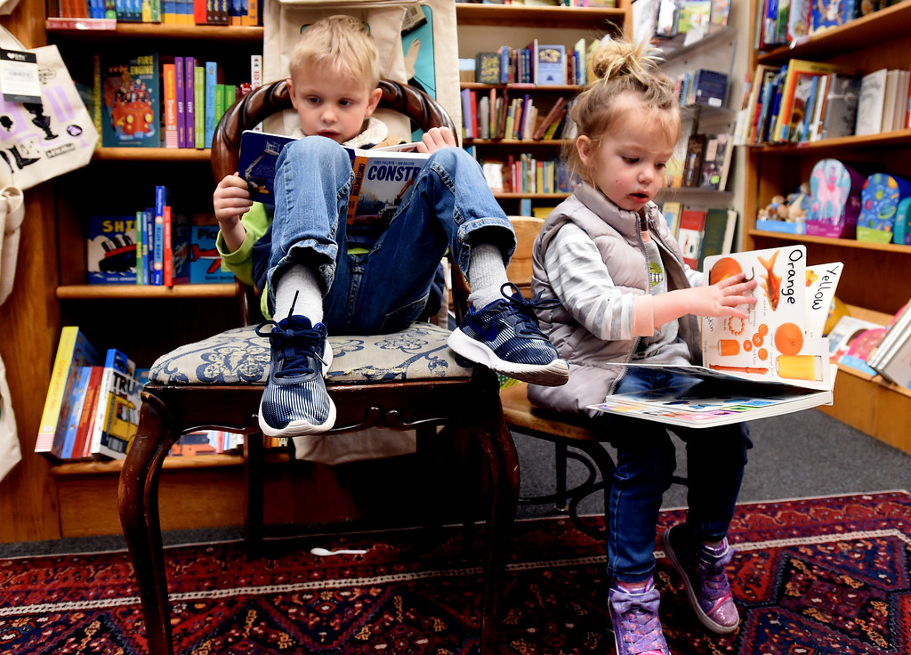 . Finn Smith, 5, and his sister, Lucy, 3 read books in the Children\'s section of the Boulder Book Store on Thursday. The Boulder Book Store was named the best book store in the country by Publisher\'s Weekly. For more photos, go to dailycamera.com. Cliff Grassmick  Photographer  March 29, 2018