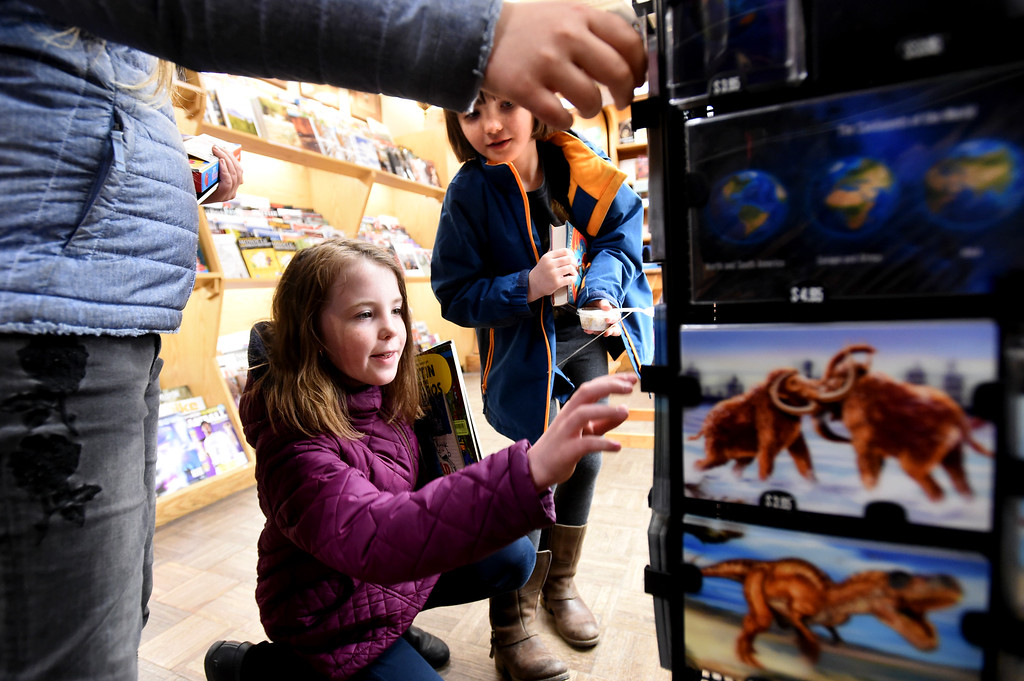 . Isabel Rueschemeyer, top, and Sophia Rueschemeyer, find some amazing cards at the Boulder Book Store on Thursday. The Boulder Book Store was named the best book store in the country by Publisher\'s Weekly. For more photos, go to dailycamera.com. Cliff Grassmick  Photographer  March 29, 2018