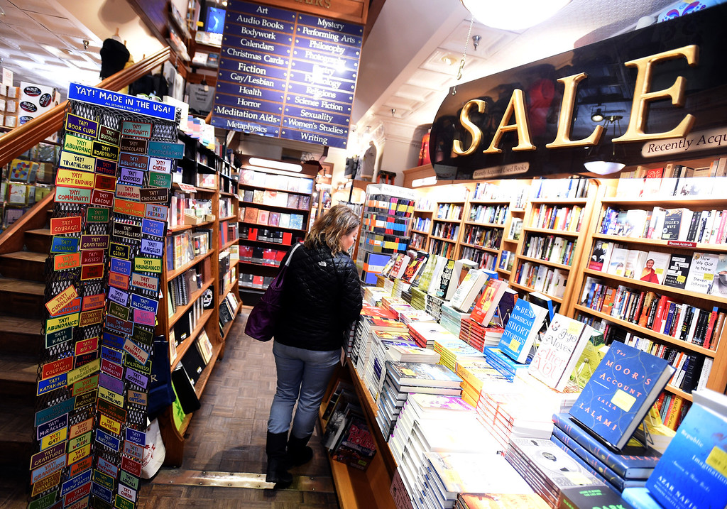 . Janet Glasser, of Lafayette, looks through books on the sale table at the Boulder Book Store on Thursday. The Boulder Book Store  was named the best book store in the country by Publisher\'s Weekly. For more photos, go to dailycamera.com. Cliff Grassmick  Photographer  March 29, 2018