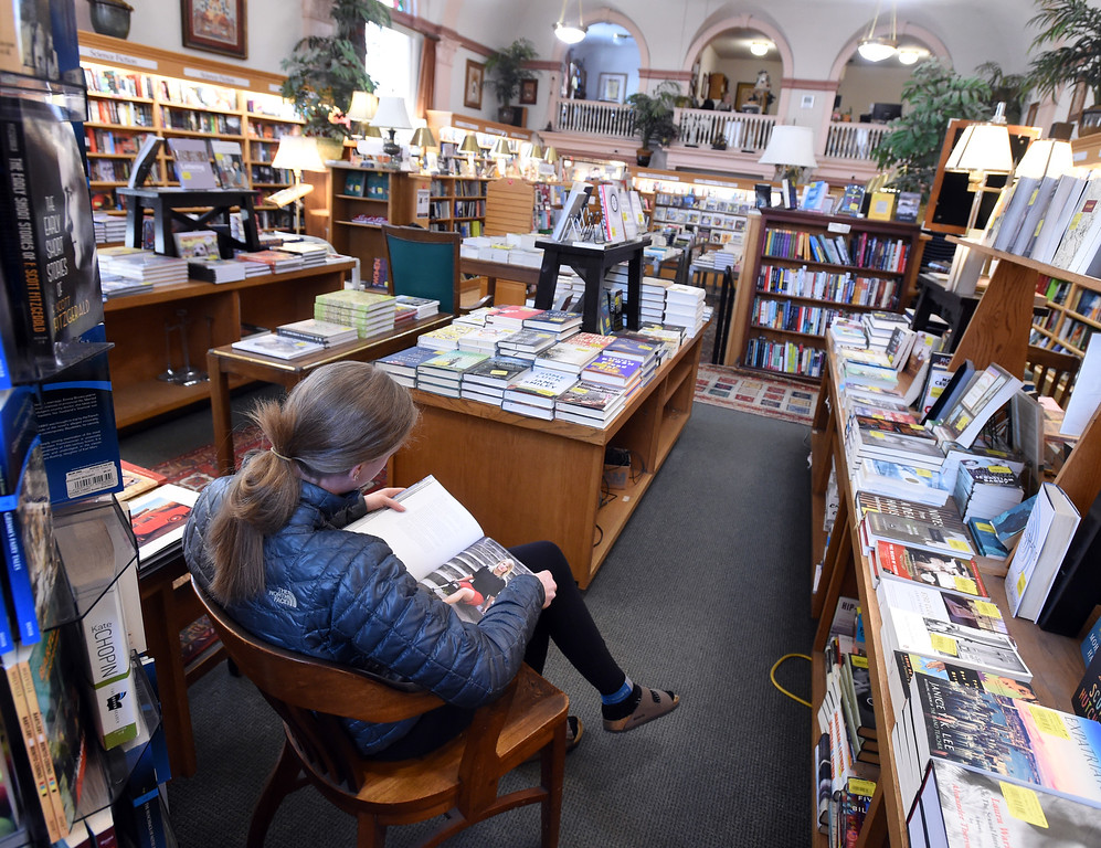 . Grace Braddock, of Broomfield, finds a quiet spot in the upstairs of the Boulder Book Store on Thursday. The Boulder Book Store  was named the best book store in the country by Publisher\'s Weekly. For more photos, go to dailycamera.com. Cliff Grassmick  Photographer  March 29, 2018