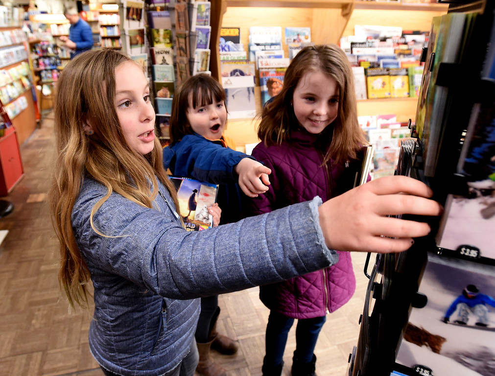 . Scarlet McBryan, left, Isabel Rueschemeyer, and Sophia Rueschemeyer, find some amazing cards at the Boulder Book Store on Thursday. The Boulder Book Store was named the best book store in the country by Publisher\'s Weekly. For more photos, go to dailycamera.com. Cliff Grassmick  Photographer  March 29, 2018