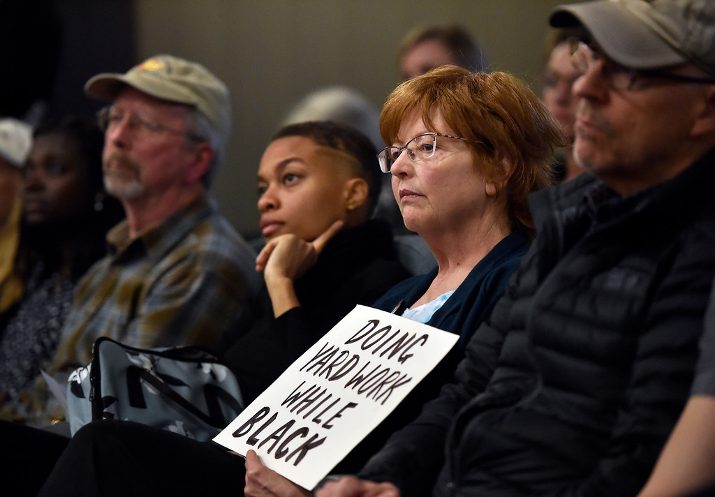 . BOULDER, CO - MARCH 18, 2019: Gloria McVeigh, of Boulder, holds a sign as she listens to a community member speak during a special Boulder City Council meeting on Monday night regarding the recent incident of racial profiling. For more photos of the meeting go to dailycamera.com (Photo by Jeremy Papasso/Staff Photographer)