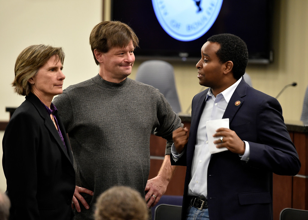 . BOULDER, CO - MARCH 18, 2019: U.S. Rep. Joe Neguse, at right, talks with Mayor Pro Tem Sam Weaver and Mayor Suzanne Jones during a special Boulder City Council meeting on Monday night regarding the recent incident of racial profiling. For more photos of the meeting go to dailycamera.com (Photo by Jeremy Papasso/Staff Photographer)