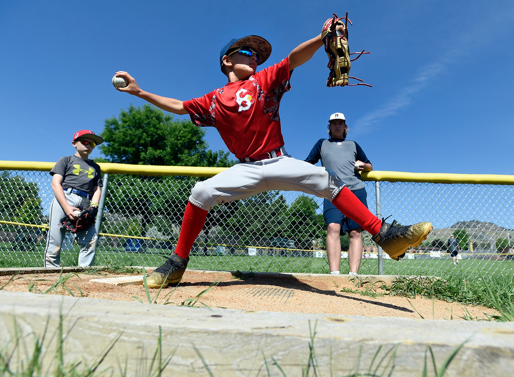 . Brody Simpson, 9, works on his pitching technique during a Boulder Collegians Youth Camp at the Iris Ballfields in Boulder on Tuesday. For more photos of the youth baseball camp go to dailycamera.com Jeremy Papasso/ Staff Photographer 06/12/2018