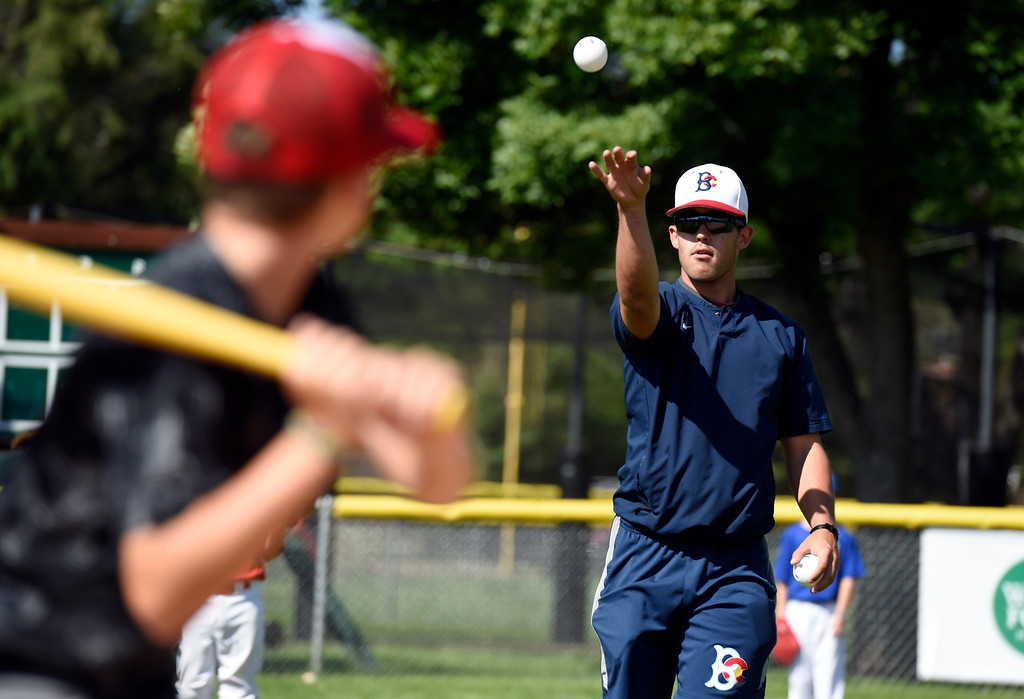 . Boulder Collegians infielder Danny Davis throws a pitch to a batter during whiffle ball scrimmage at a Boulder Collegians Youth Camp at the Iris Ballfields in Boulder on Tuesday. For more photos of the youth baseball camp go to dailycamera.com Jeremy Papasso/ Staff Photographer 06/12/2018