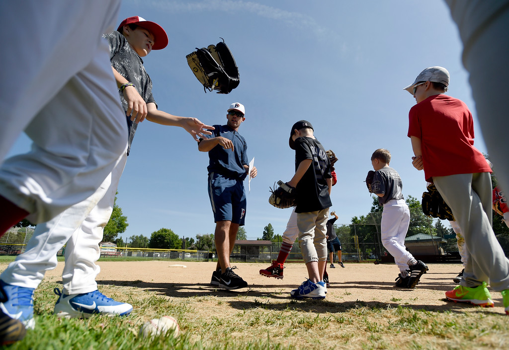 . Boulder Collegians infielder Danny Davis sends little league players to different exercise groups during a Boulder Collegians Youth Camp at the Iris Ballfields in Boulder on Tuesday. For more photos of the youth baseball camp go to dailycamera.com Jeremy Papasso/ Staff Photographer 06/12/2018