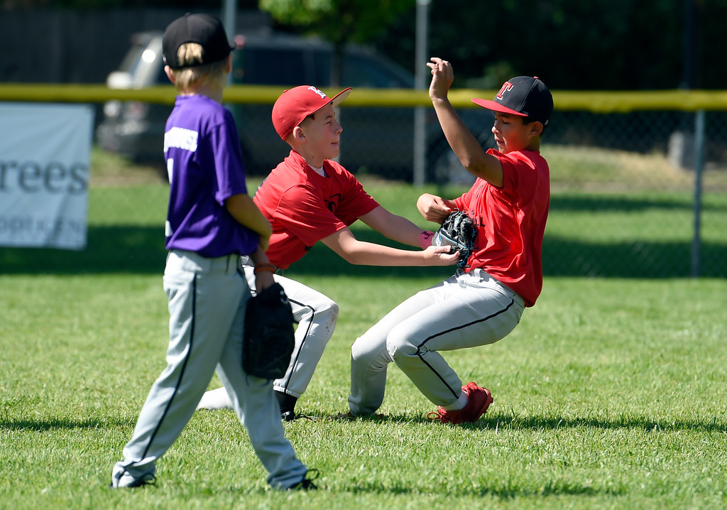 . Theo Skinner, 11, tags out Max Mata, 11, at second base while playing a whiffle ball scrimmage during a Boulder Collegians Youth Camp at the Iris Ballfields in Boulder on Tuesday. For more photos of the youth baseball camp go to dailycamera.com Jeremy Papasso/ Staff Photographer 06/12/2018
