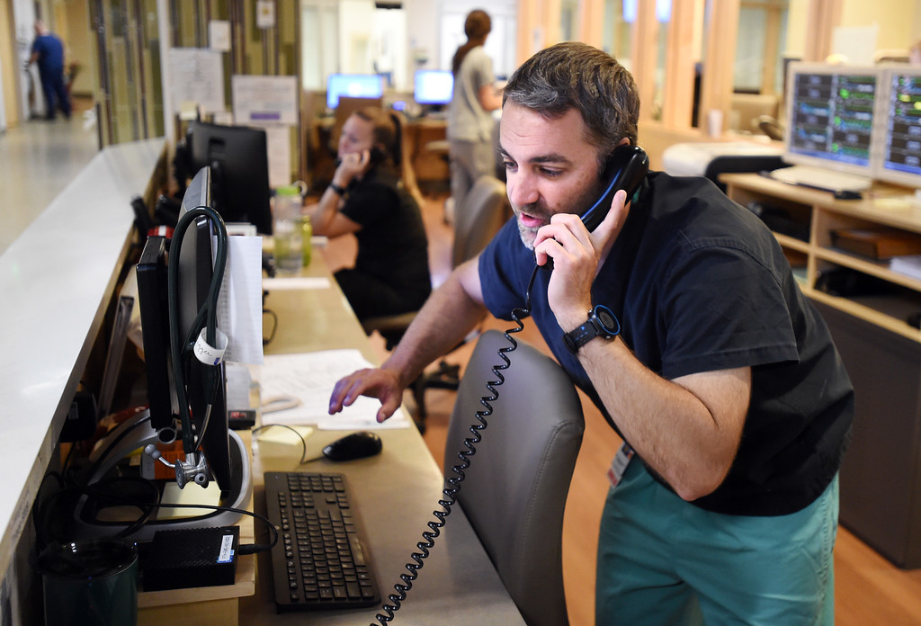 . Dr. Scott Hammerich takes a call at the Boulder Foothills Hospital emergency room on Friday.  Doctors in ER\'s around Boulder County are working to reduce their use of opioids as the epidemic rages on across the country. Cliff Grassmick  Staff Photographer  June 22, 2018