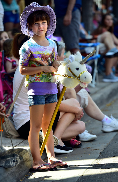 . LONGMONT, CO - AUGUST 4 2018 Maysa McKay, 7, and her horse watch the annual Boulder County Fair Parade in Longmont Colorado on Saturday August 4, 2018.  (Photo by Paul Aiken/Staff Photographer)