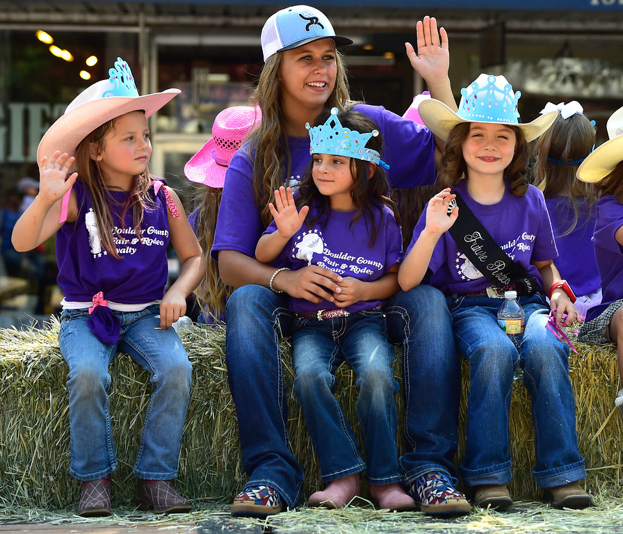 . LONGMONT, CO - AUGUST 4 2018 From left to right Brielle Upchurch, Cayley Sheyne, Rori (who couldn\'t spell her last name) and Caden Tesch wave to the crowd as future fair princesses during the annual Boulder County Fair Parade in Longmont Colorado on Saturday August 4, 2018.  (Photo by Paul Aiken/Staff Photographer)