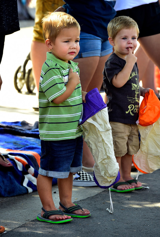 . LONGMONT, CO - AUGUST 4 2018 Kane Dodson, 3, holds his hand over his heart as a color guard with flags pass by as he and his brother Marshall, 2, at right watch the annual Boulder County Fair Parade in Longmont Colorado on Saturday August 4, 2018.  (Photo by Paul Aiken/Staff Photographer)