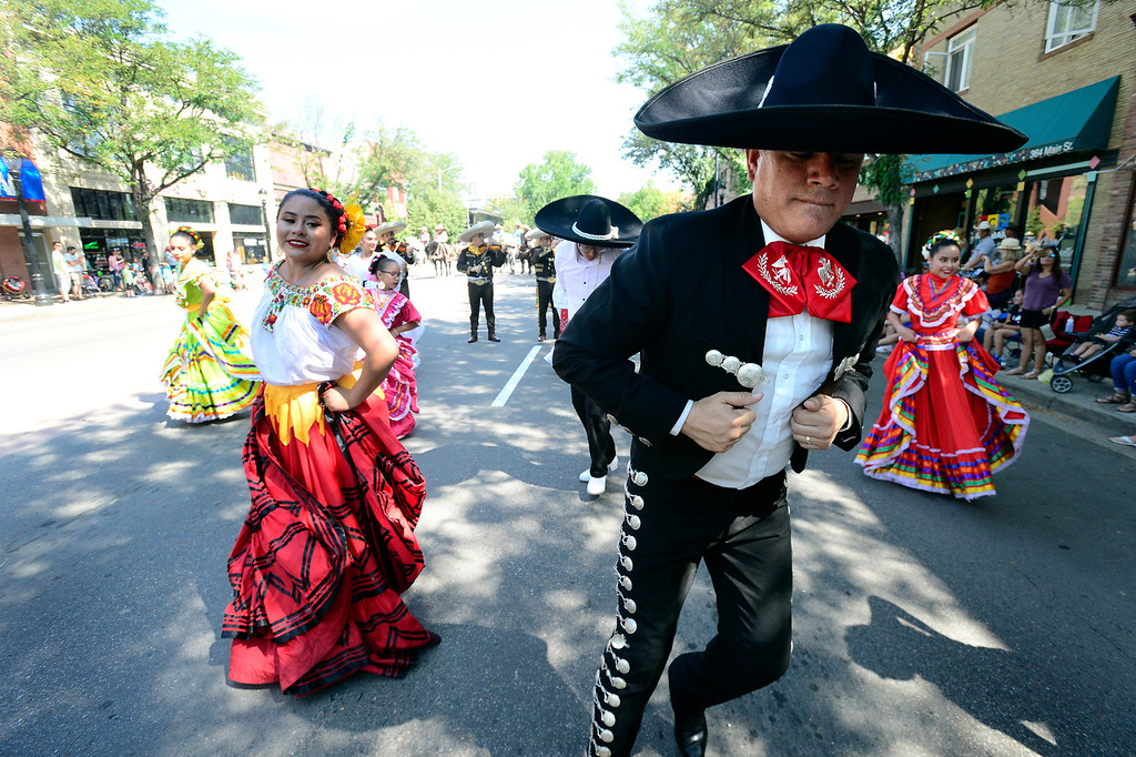 . LONGMONT, CO - AUGUST 4 2018 Emily Garcia and Hugo Esquibel of Mexico Lindo dance during the annual Boulder County Fair Parade in Longmont Colorado on Saturday August 4, 2018.  (Photo by Paul Aiken/Staff Photographer)