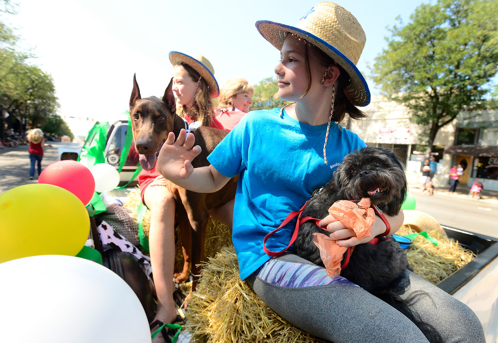. LONGMONT, CO - AUGUST 4 2018 Annika Young with Marley the dog rides on the 4H Dog Club float during the annual Boulder County Fair Parade in Longmont Colorado on Saturday August 4, 2018.  (Photo by Paul Aiken/Staff Photographer)
