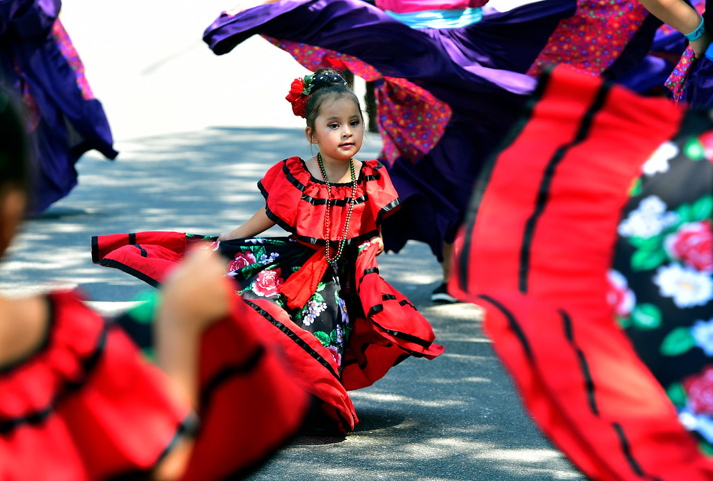 . LONGMONT, CO - AUGUST 4 2018 Jaleyza Recendiz performs a traditional dance during the annual Boulder County Fair Parade in Longmont Colorado on Saturday August 4, 2018.  (Photo by Paul Aiken/Staff Photographer)