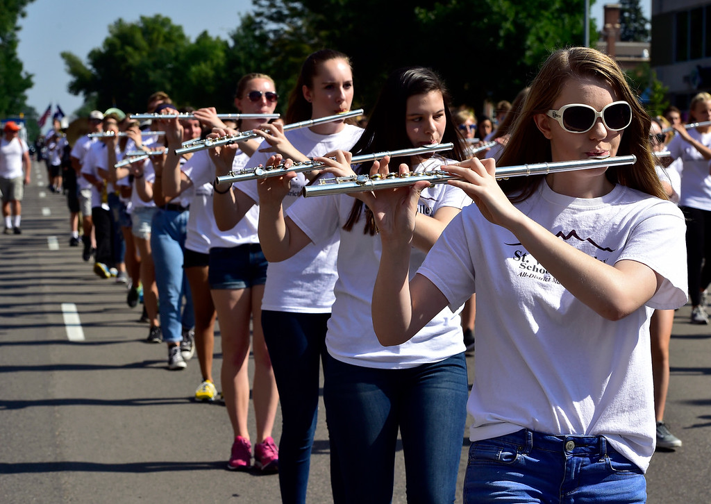 . LONGMONT, CO - AUGUST 4 2018 Camryn Knudson, marches along with the St. Vrain Valley School District Combined Marching Band during the annual Boulder County Fair Parade in Longmont Colorado on Saturday August 4, 2018.  (Photo by Paul Aiken/Staff Photographer)