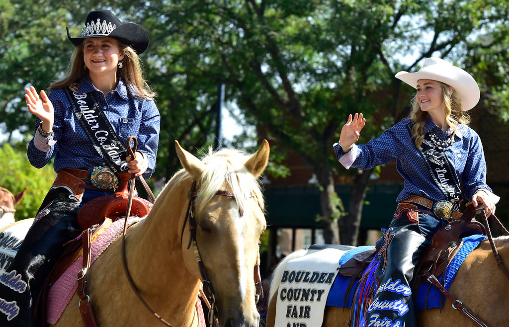 . LONGMONT, CO - AUGUST 4 2018 Boulder County Fair Queen Sydney Postle, left, and Lady in Waiting Kaitlyn Saye wave to the crowd during the annual Boulder County Fair Parade in Longmont Colorado on Saturday August 4, 2018.  (Photo by Paul Aiken/Staff Photographer)