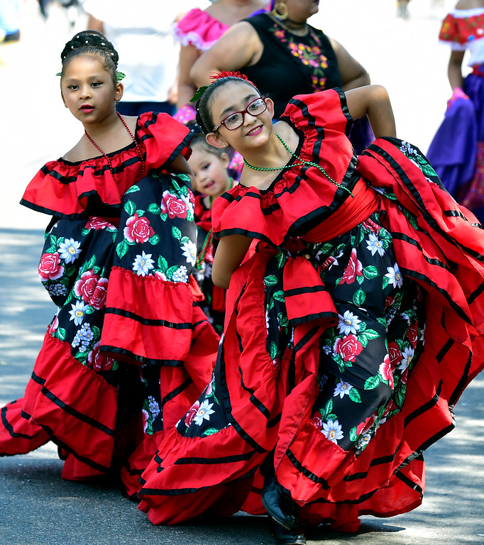 . LONGMONT, CO - AUGUST 4 2018 Jozelynn Recendiz, left, and Nayla Onofre perform a traditional dance during the annual Boulder County Fair Parade in Longmont Colorado on Saturday August 4, 2018.  (Photo by Paul Aiken/Staff Photographer)