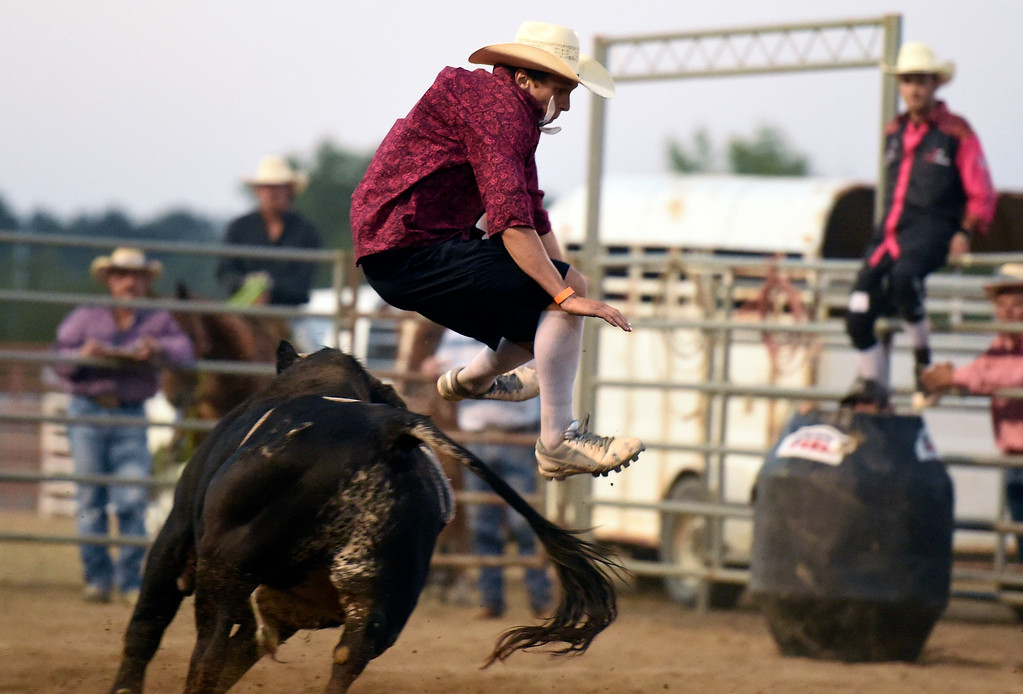 . Bullfighter Bailey Ziel jumps over a charging bull during the Boulder County Fair on Friday night at the Boulder County Fairgrounds in Longmont. For more photos of the rodeo go to dailycamera.com Jeremy Papasso/ Staff Photographer 08/10/2018