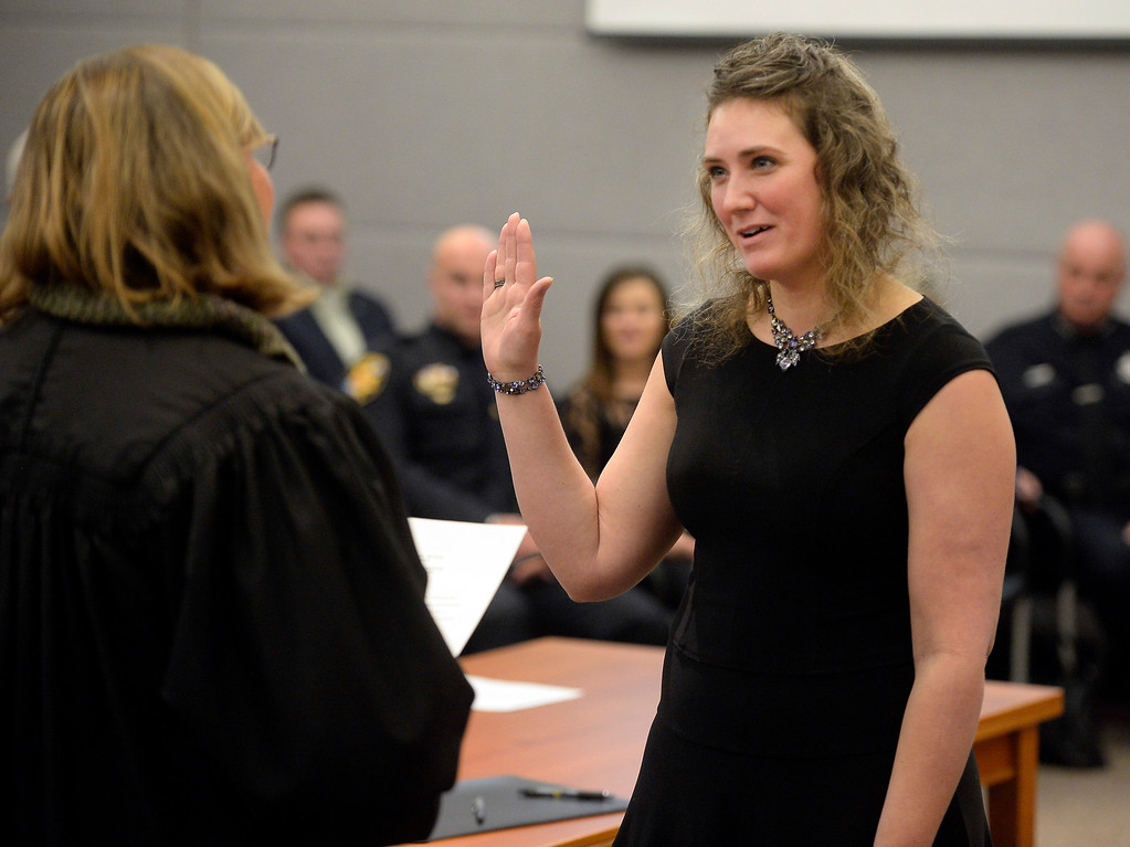 . BOULDER, CO - January 8, 2019: Boulder County Coroner, Emma Hall, is being sworn in by Judge Ingrid Bakke. Boulder County  officials took their oaths of office on Tuesday January 8, 2019 at the Boulder County Courthouse. (Photo by Cliff Grassmick/Staff Photographer)