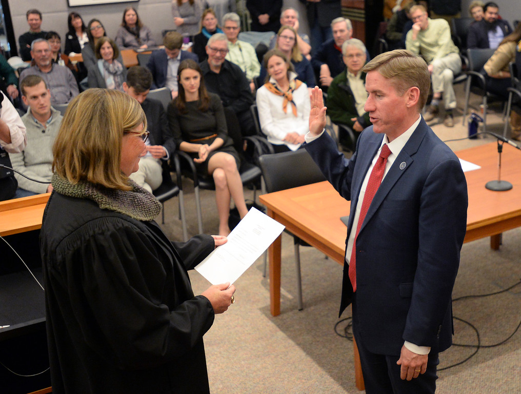 . BOULDER, CO - January 8, 2019: Boulder County District Attorney, Michael Dougherty, is being sworn in by Judge Ingrid Bakke.  Boulder County  officials took their oaths of office on Tuesday January 8, 2019 at the Boulder County Courthouse. (Photo by Cliff Grassmick/Staff Photographer)