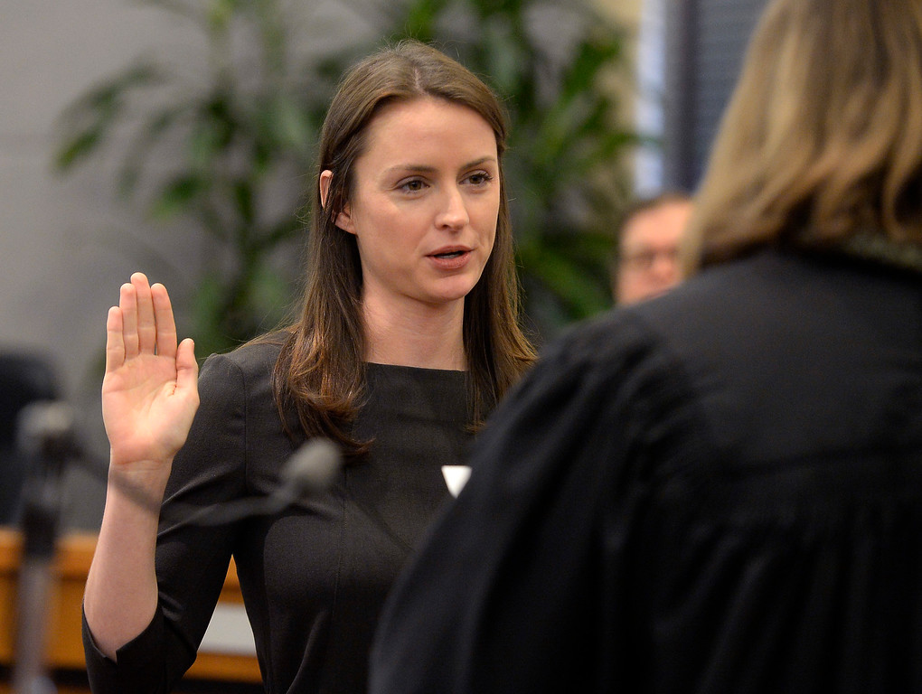 . BOULDER, CO - January 8, 2019: New Boulder County Clerk and Recorder, Molly Fitzpatrick, is being sworn in by Judge Ingrid Bakke. Boulder County  officials took their oaths of office on Tuesday January 8, 2019 at the Boulder County Courthouse. (Photo by Cliff Grassmick/Staff Photographer)