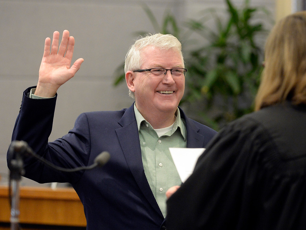. BOULDER, CO - January 8, 2019: New Boulder County Commissioner, Matt Jones, is being sworn in by Judge Ingrid Bakke.  Boulder County  officials took their oaths of office on Tuesday January 8, 2019 at the Boulder County Courthouse. (Photo by Cliff Grassmick/Staff Photographer)