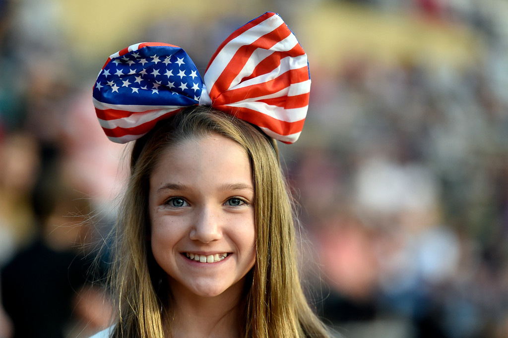 . Jewelia Nix, 12, smiles as she wears a giant American themed bow on her head during the Ralphie\'s Independence Day Blast at Folsom Field on the University of Colorado campus in Boulder. For more photos of the event go to dailycamera.com Jeremy Papasso/ Staff Photographer 07/04/2018