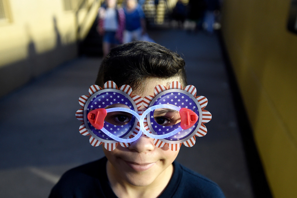 . Alex Garcia, 10, wears American themed glasses during the Ralphie\'s Independence Day Blast at Folsom Field on the University of Colorado campus in Boulder. For more photos of the event go to dailycamera.com Jeremy Papasso/ Staff Photographer 07/04/2018