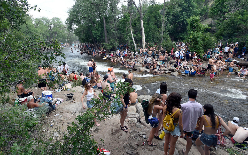 . Very crowded shorelines at the Boulder Creek on Wednesday, in Boulder. For more photos of the overcrowded Boulder Creek go to dailycamera.com Jeremy Papasso/ Staff Photographer 07/04/2018