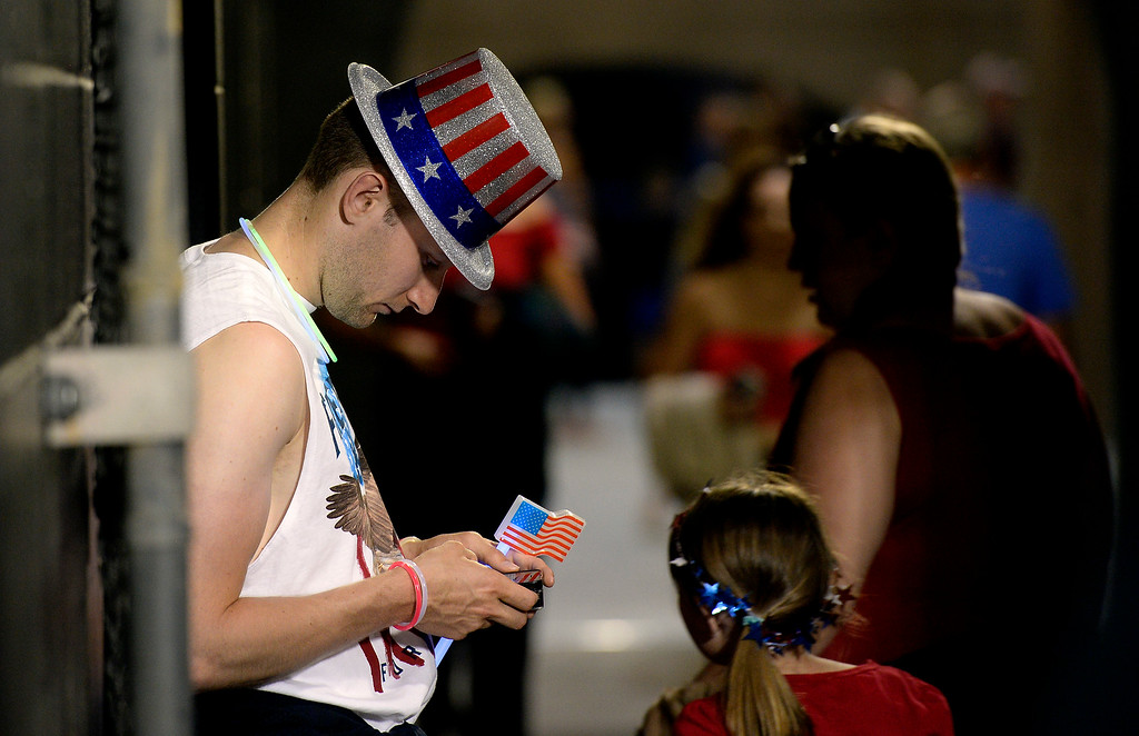 . Tom Brendling waits for his girlfriend by the bathrooms while sporting American themed clothes during the Ralphie\'s Independence Day Blast at Folsom Field on the University of Colorado campus in Boulder. For more photos of the event go to dailycamera.com Jeremy Papasso/ Staff Photographer 07/04/2018