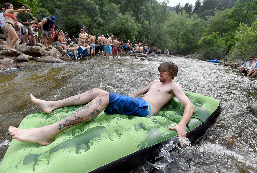 . A man, not identified, rides an inflatable raft down a rapid at the Boulder Creek on Wednesday, in Boulder. For more photos of the overcrowded Boulder Creek go to dailycamera.com Jeremy Papasso/ Staff Photographer 07/04/2018