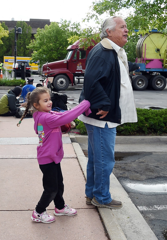 . Xiumara Burgos, 5, pulls on her grandfather, Gary Moore, owner of the carnival. Staff from Gary Moore Amusements are putting together the carnival rides along Boulder Creek Friday morning. For more photos, go to www.dailycamera.com.  Cliff Grassmick  Staff Photographer May 26, 2017