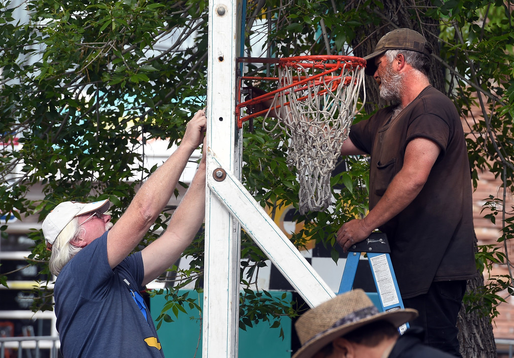. Robert Stevens, left, and Terry Gardner, put up a basketball hoop for the carnival. Staff from Gary Moore Amusements are putting together the carnival rides along Boulder Creek Friday morning. For more photos, go to www.dailycamera.com.  Cliff Grassmick  Staff Photographer May 26, 2017