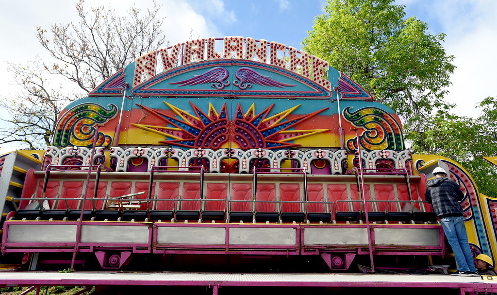 . Workers get the Avalanche ride ready for the weekend. Staff from Gary Moore Amusements are putting together the carnival rides along Boulder Creek Friday morning. For more photos, go to www.dailycamera.com.  Cliff Grassmick  Staff Photographer May 26, 2017