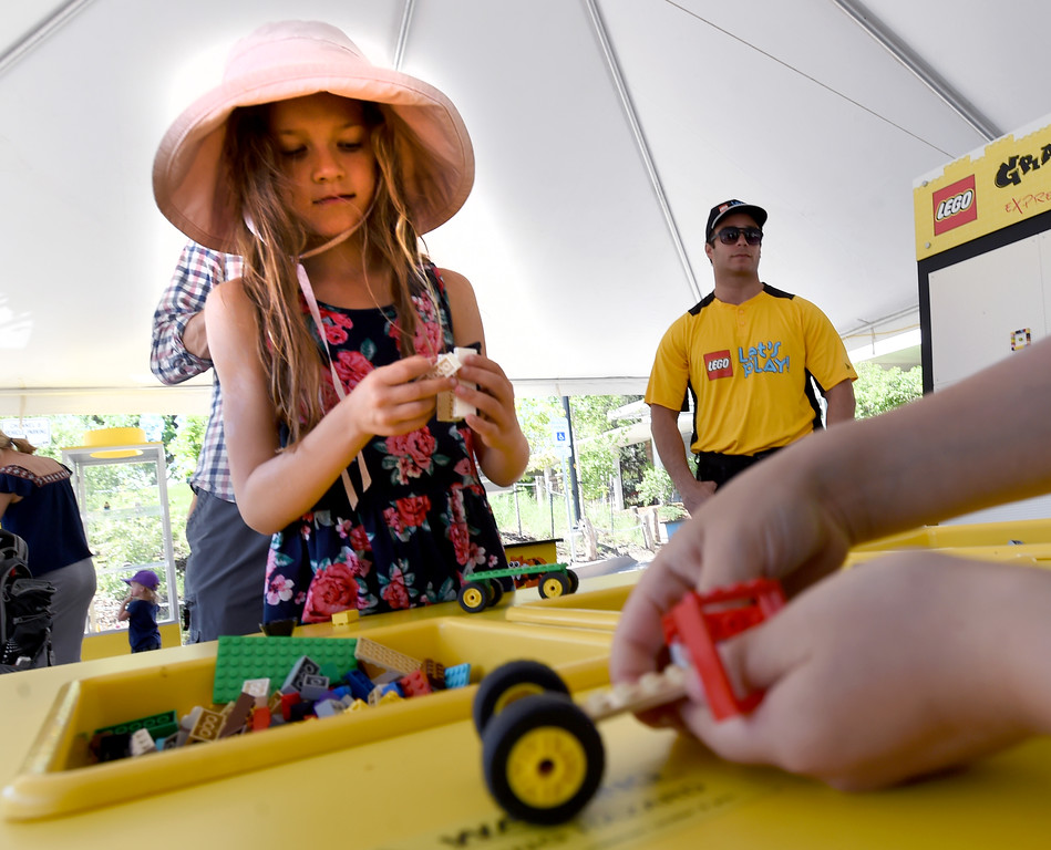 . Violette Edstrom, 9,  plays in the Lego tent with her brother, Christian, 6, at the creek festival on Saturday. The Boulder Creek Festival is free to the public and and has  9 separate event areas with 500 vendors showcase everything from community arts and crafts to healthier alternatives and technology while 3 performance stages feature a spectrum of music and dance.  The festival also features carnival rides and food and beverage vendors. The festival continues through Monday. For for more photos, go to dailycamera.com. Cliff Grassmick  Photographer  May 26,  2018