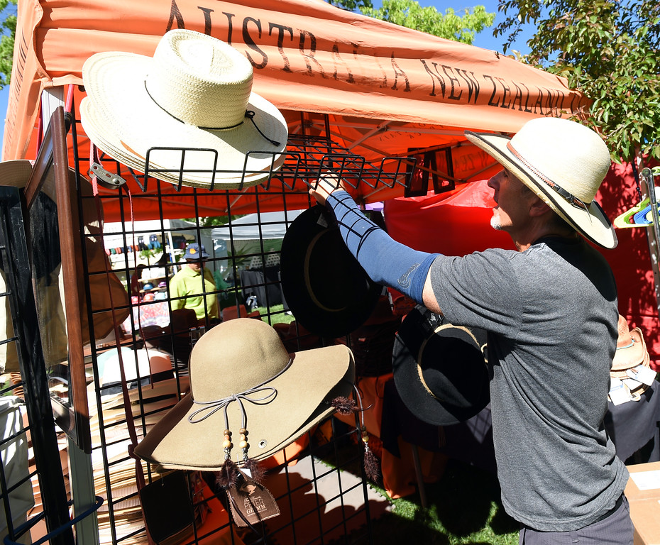 . Brett Robben arranges hats at RMO Hats at the festival on Saturday. The Boulder Creek Festival is free to the public and and has  9 separate event areas with 500 vendors showcase everything from community arts and crafts to healthier alternatives and technology while 3 performance stages feature a spectrum of music and dance.  The festival also features carnival rides and food and beverage vendors. The festival continues through Monday. For for more photos, go to dailycamera.com. Cliff Grassmick  Photographer  May 26,  2018
