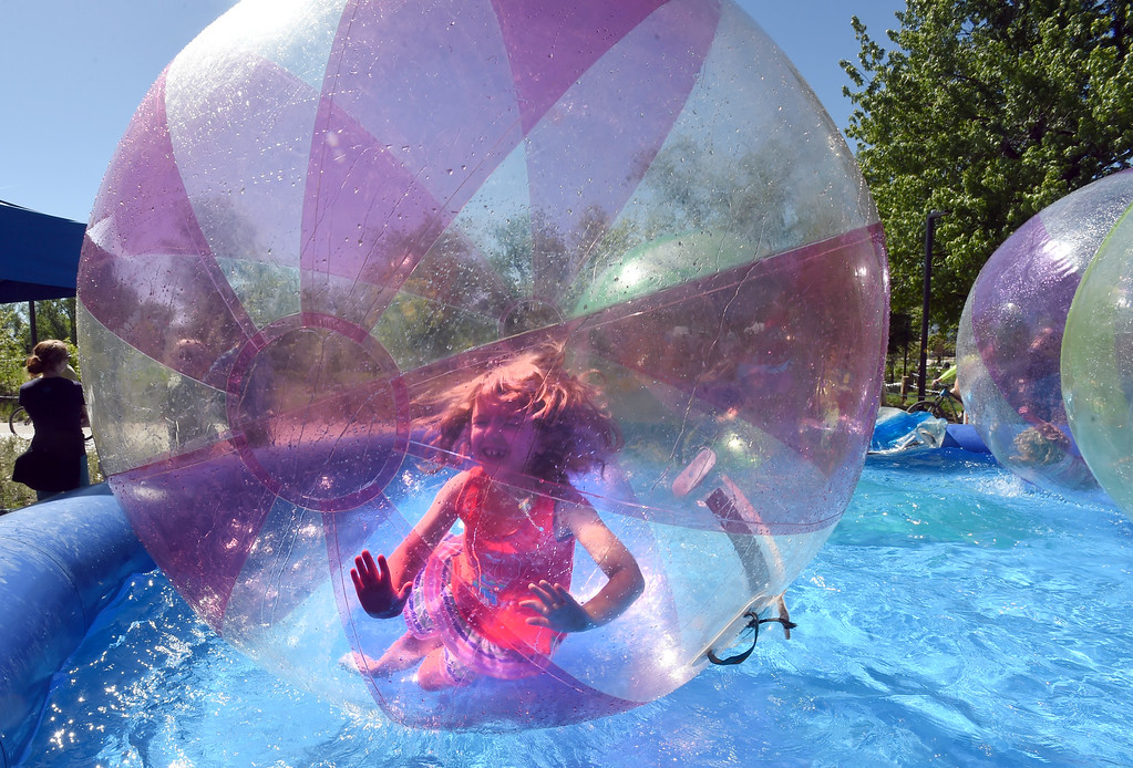 . Saoirse Rogers, 6, rolls around in the large bubbles at the creek festival on Saturday. The Boulder Creek Festival is free to the public and and has  9 separate event areas with 500 vendors showcase everything from community arts and crafts to healthier alternatives and technology while 3 performance stages feature a spectrum of music and dance.  The festival also features carnival rides and food and beverage vendors. The festival continues through Monday. For for more photos, go to dailycamera.com. Cliff Grassmick  Photographer  May 26,  2018