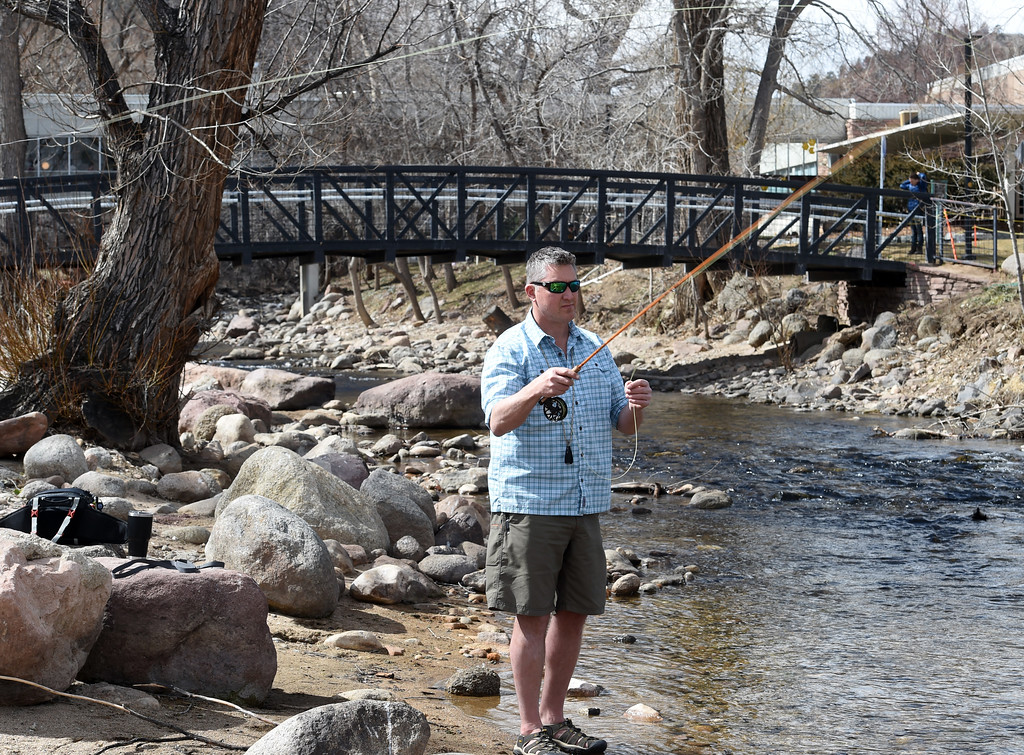 . Ken Barnes takes time out to fly fish in Boulder Creek. Several people were enjoying Boulder Creek near the Boulder Public Library on Friday. For more photos, go to dailycamera.com. Cliff Grassmick  Photographer  March 9, 2018